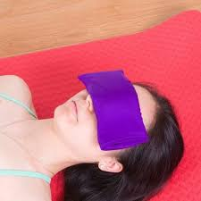 A woman sleeping wearing a yoga eye pillow