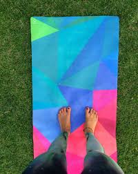 A Yoga design lab mat and towel in a blog by Durga Yoga