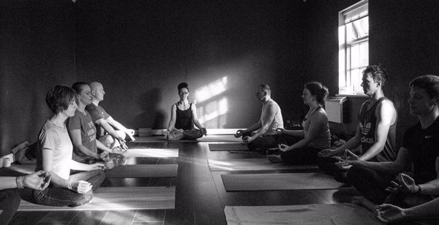 Durga yoga teacher trainees meditating