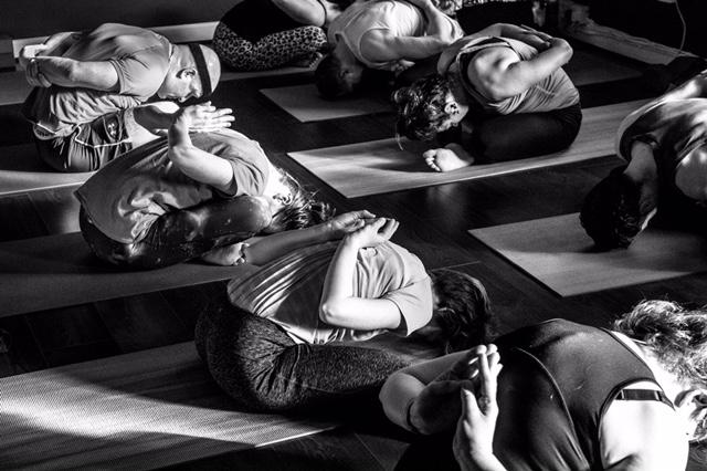 Durga yoga teacher trainees practising yoga