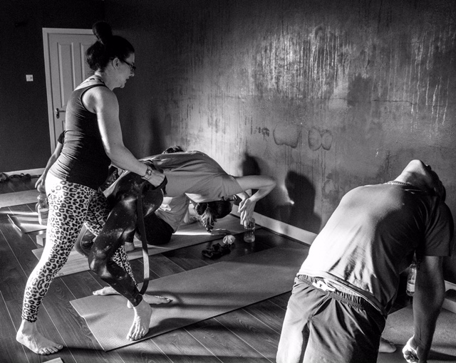 a yoga student doing a drop back